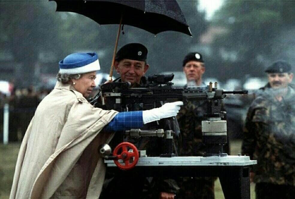 queen shooting a gun