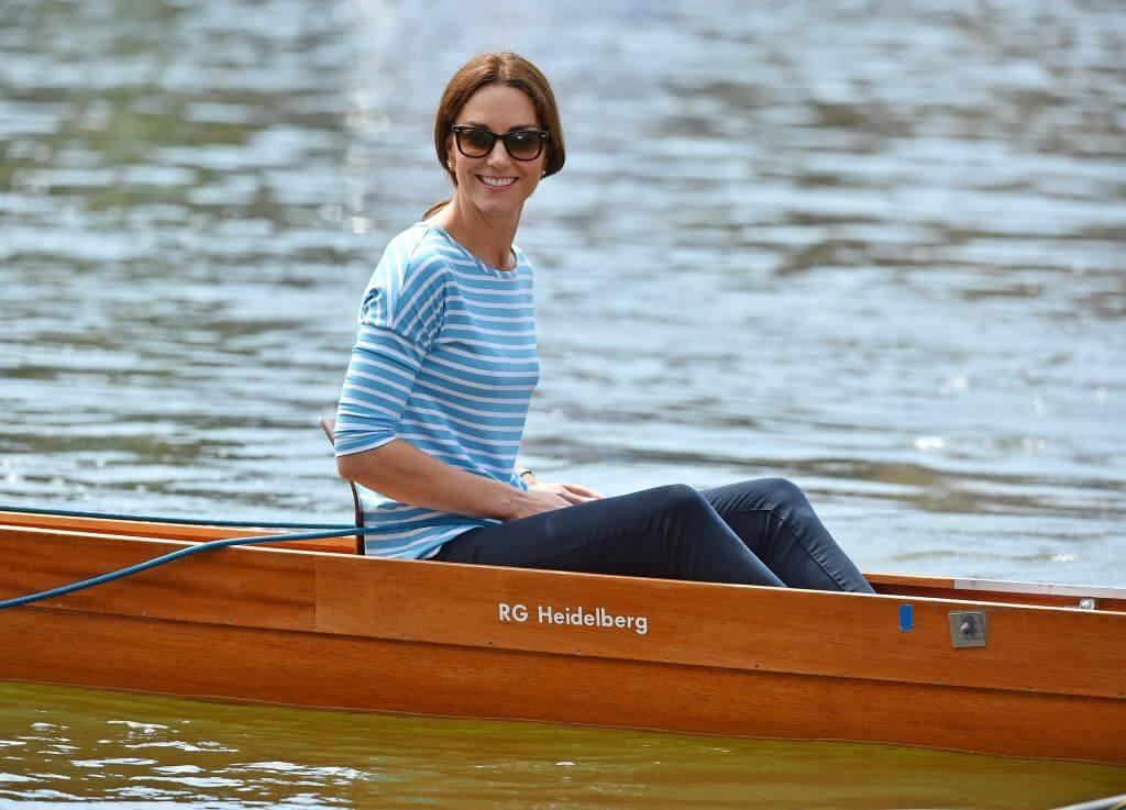 Kate Middleton in canoe wearing stripped blue shirt