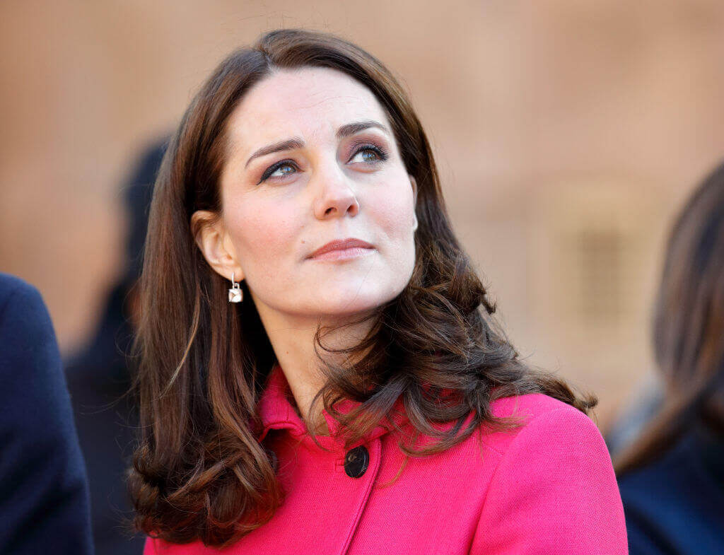 Kate-Middleton-mysterious look well dressed pondering