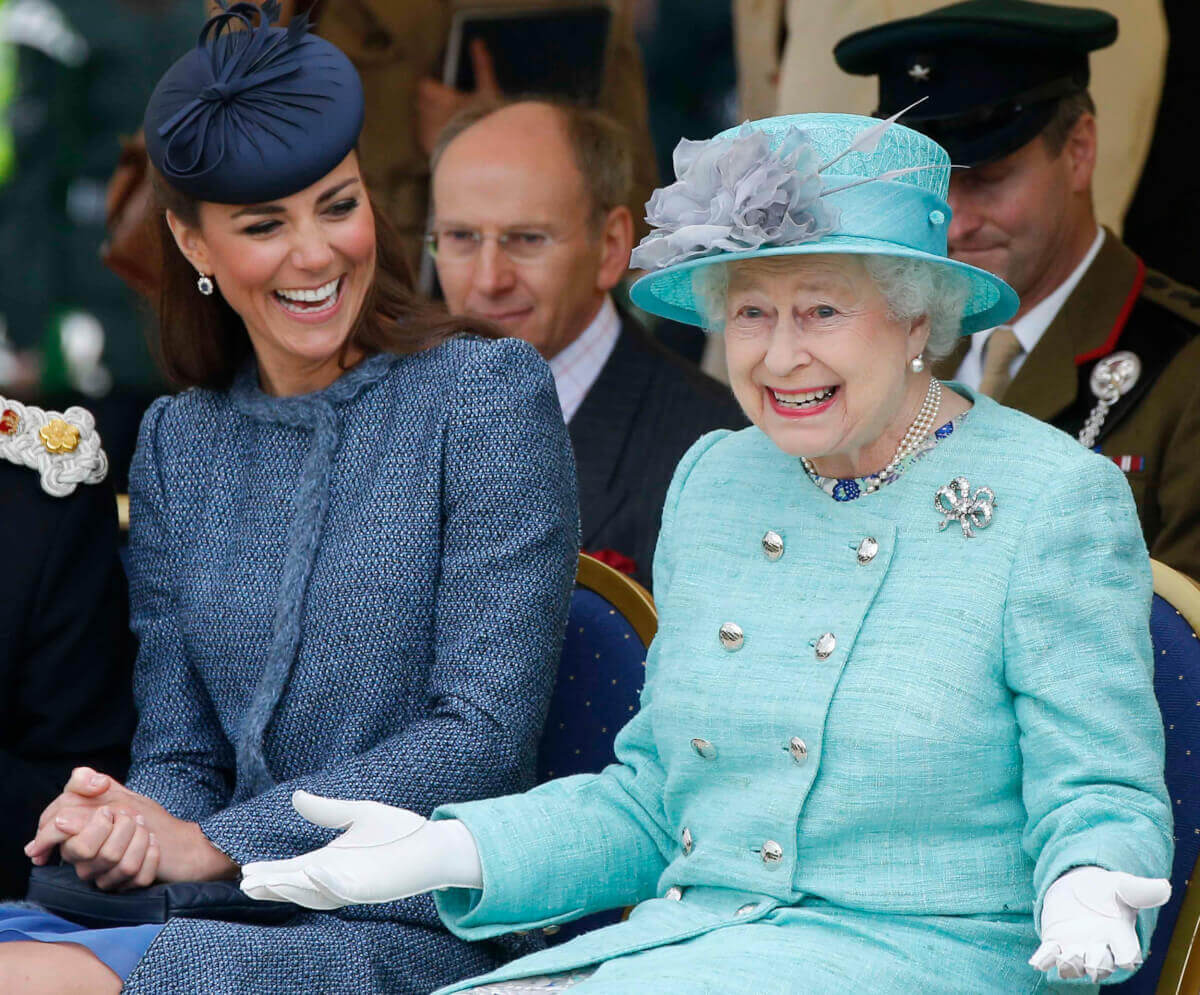 Kate-Middleton-next to Queen smiling and laughing