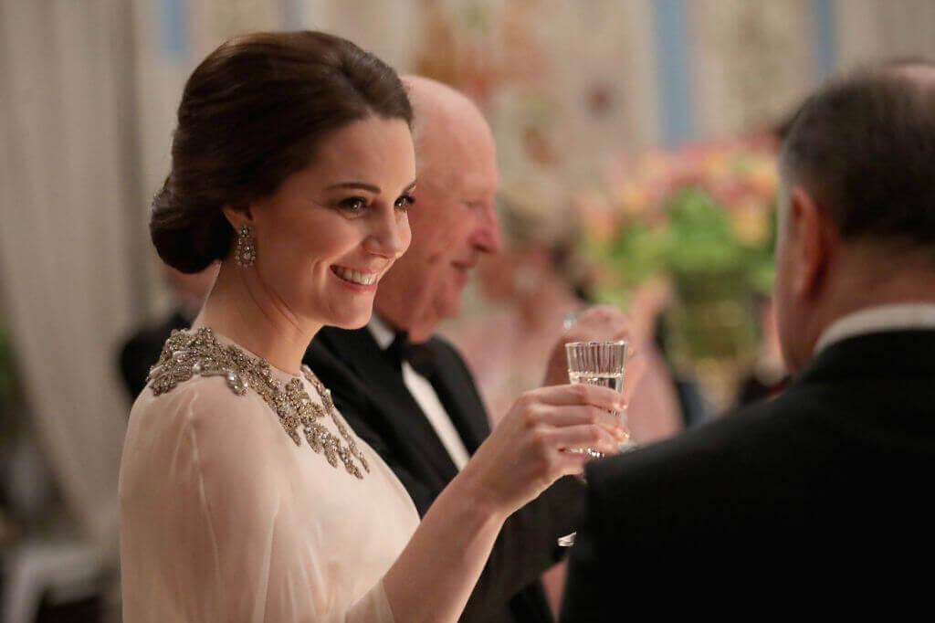 Kate-Middleton raising glass to old man