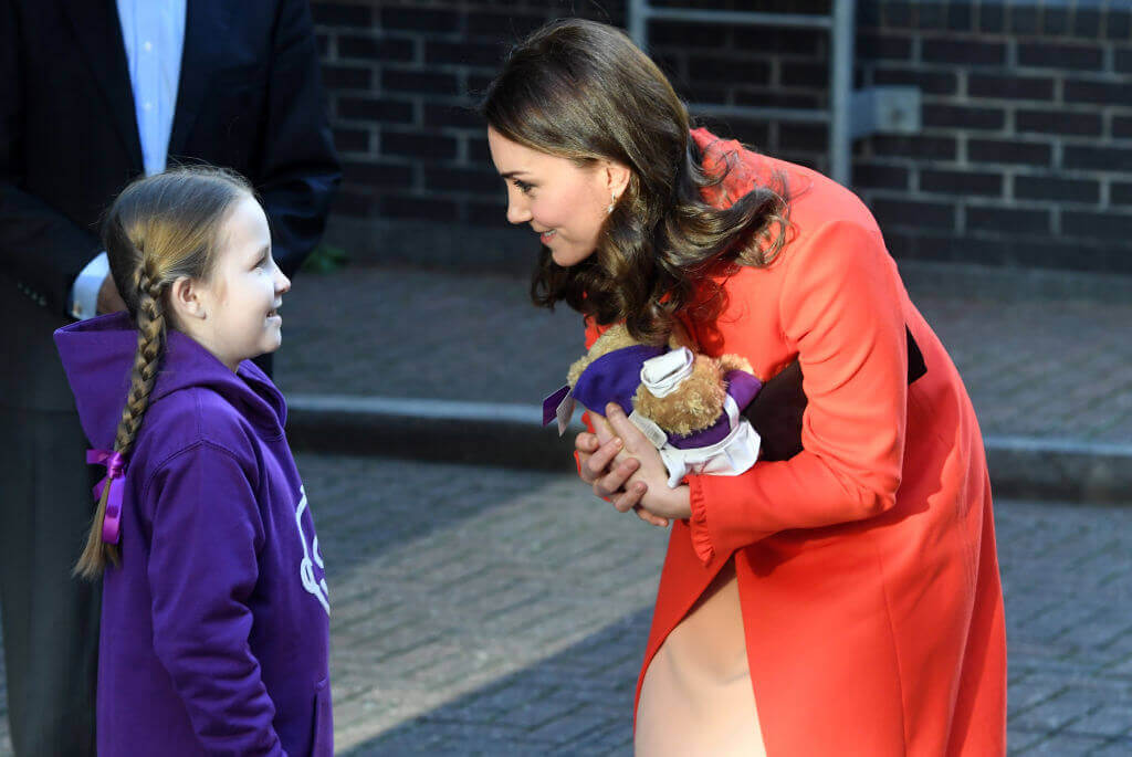 Kate-Middleton-receiving gifts consisting of teddy bear