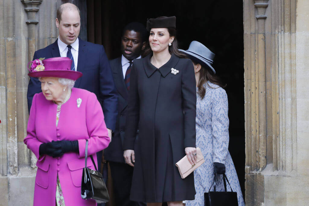 Kate wearing black and Queen wearing purple