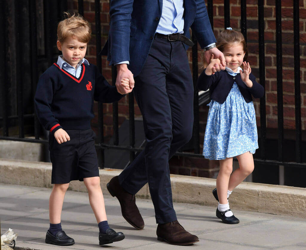 William walking with children as they look at others