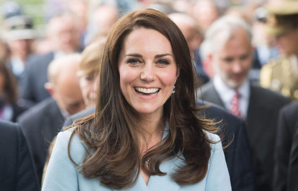 Kate smiling with long brown hair