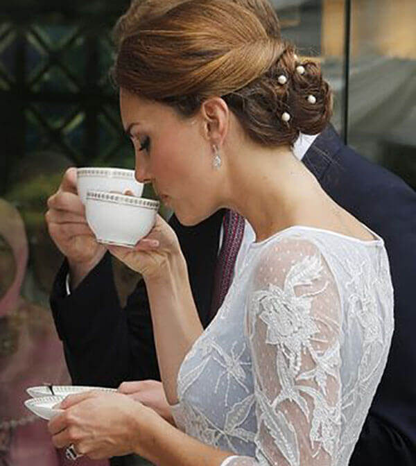 Kate drinking tea with fancy hand gestures