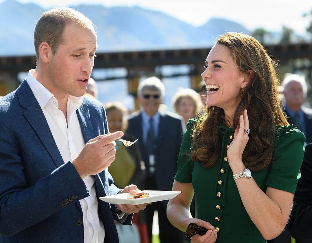 Kate Middleton and Prince William laughing while eating