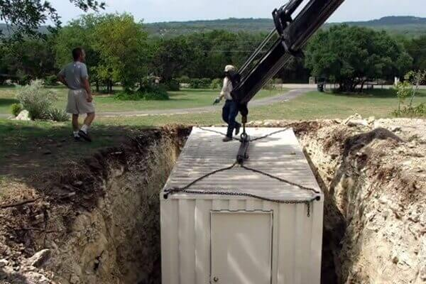digahole6-container being placed in hole
