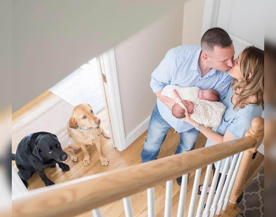 kissing couple twins dogs in house