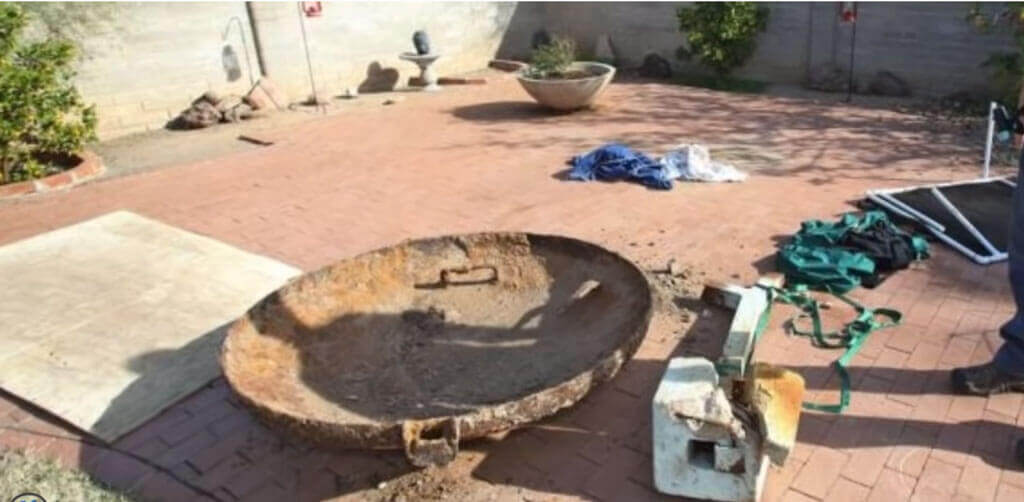 man-makes-discovery-in-arizona-18-lid back porch out of hole