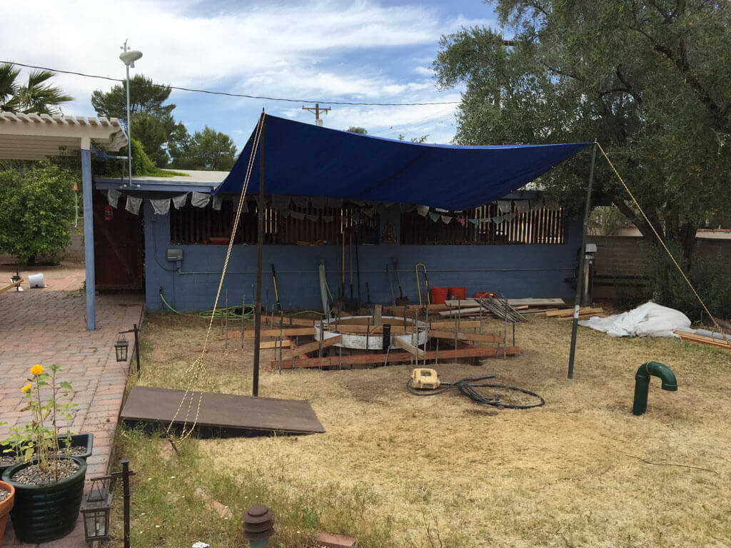 man-makes-discovery-in-arizona-25-tarp over hole backyard