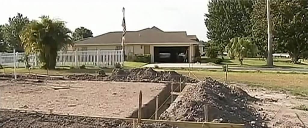 neighbor-war-construction front yard