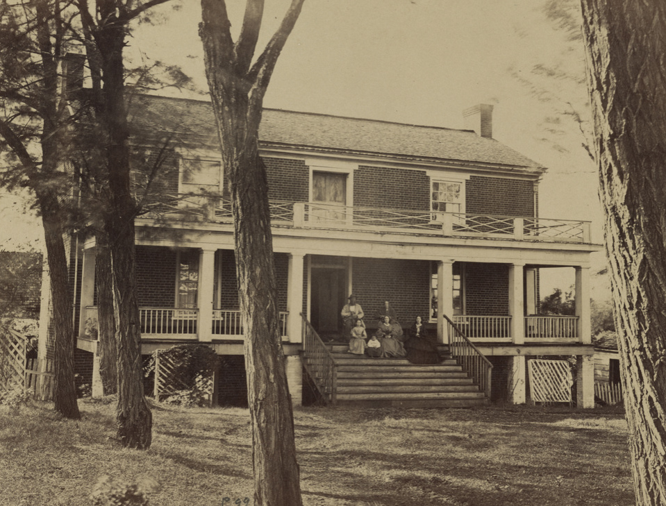 Wilmer McLean and his family sit on the porch of his house, where Confederate Gen. Robert E. Lee signed the terms of surrender to U.S. Gen. Ulysses S. Grant, in April, 1865