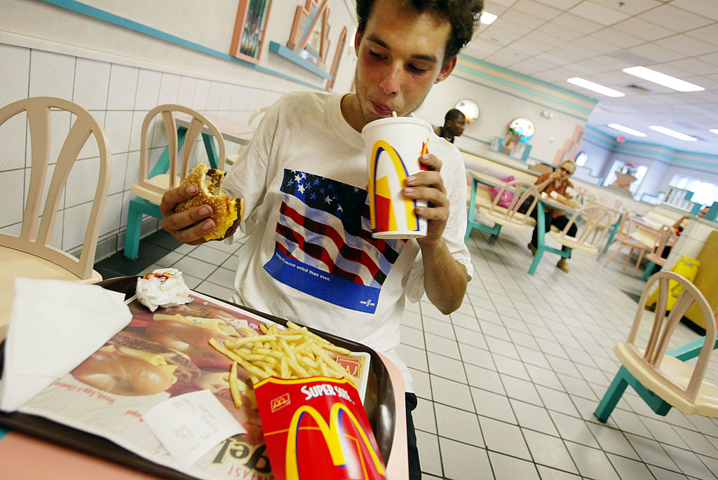 eff Baughman takes a sip of his Super Coke as he eats his Double Quarterpounder with cheese along with a Super Fry