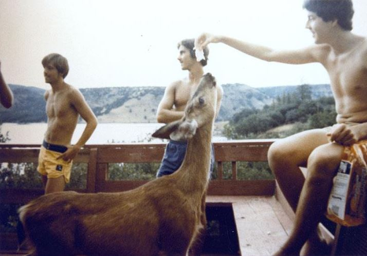 John Warlow feeding a deer at the cabin in Copco Lake, CA