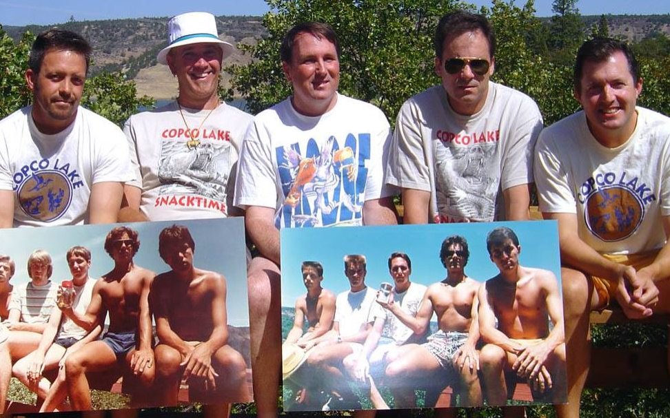 the five friends holding prints of their older photos
