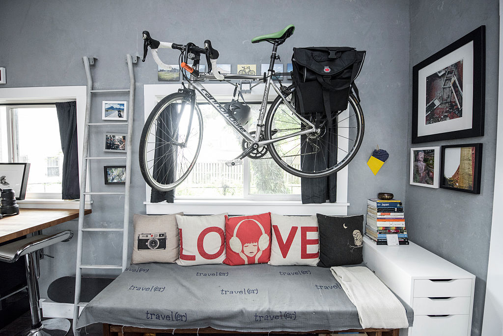 bike hanging over top of couch to save space