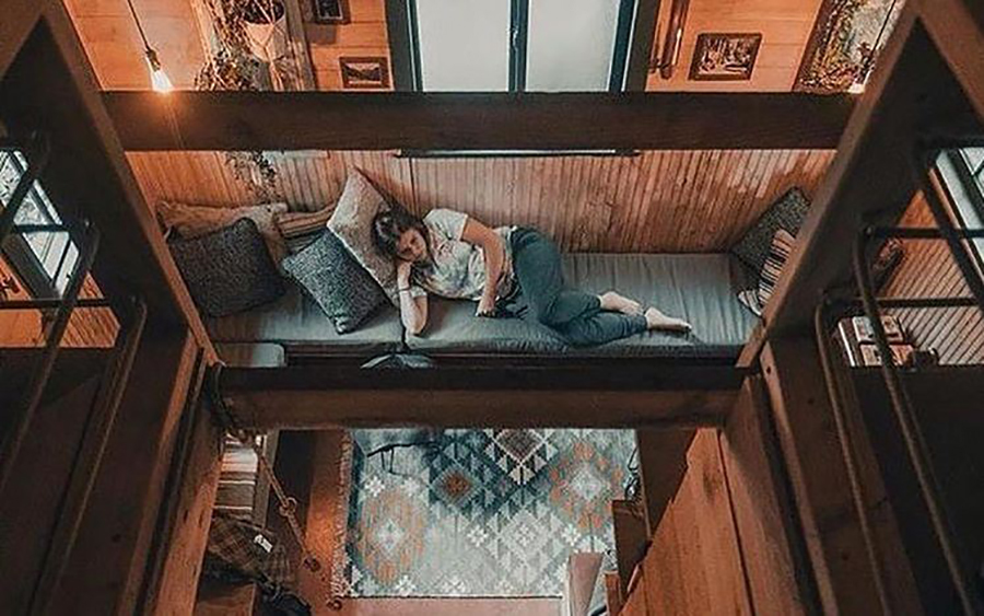 woman laying alone in tiny house