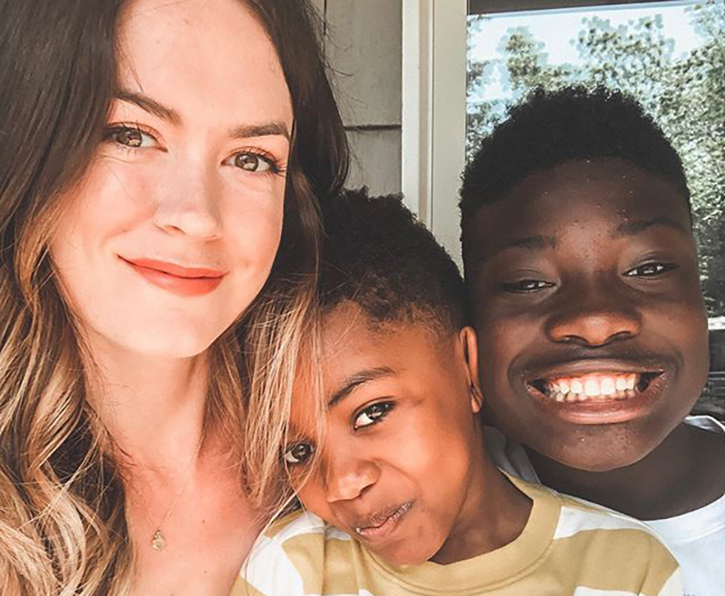 Sara Cozad with fostered kids, Dayshawn and Michael