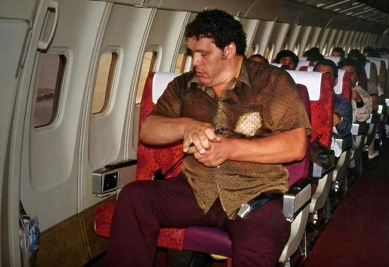 andre the giant on a plane in the 1980s