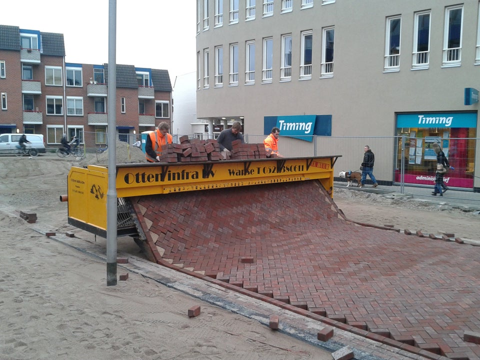 machine laying bricks for a road in the netherlands