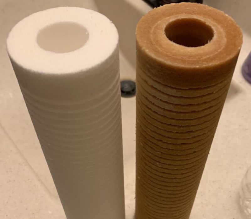 brown water filter versus white new one