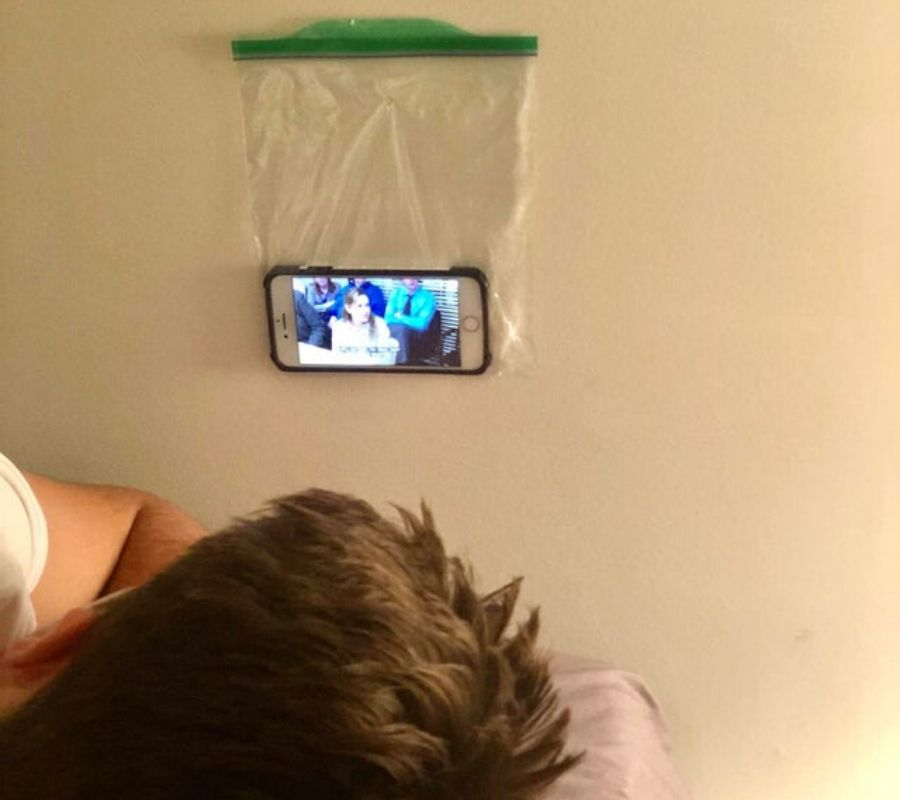 someone put their phone in a plastic bag tacked to the wall so they could watch a movie