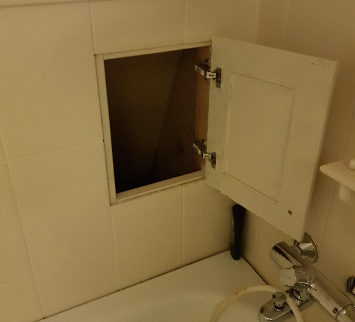 A laundry chute in the second-floor bathroom leads to the laundry room on the first floor.