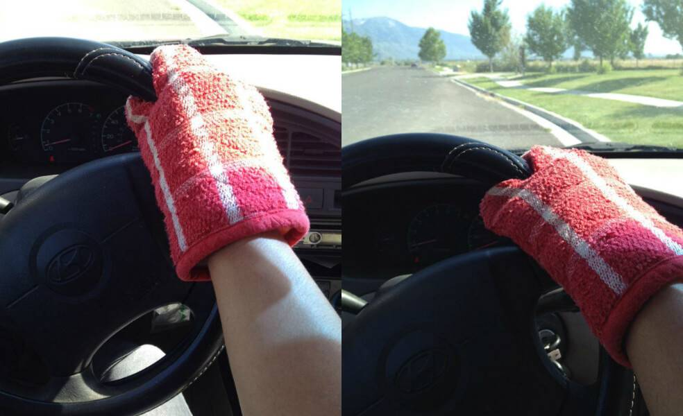 person using oven mitt to drive because steering wheel is hot