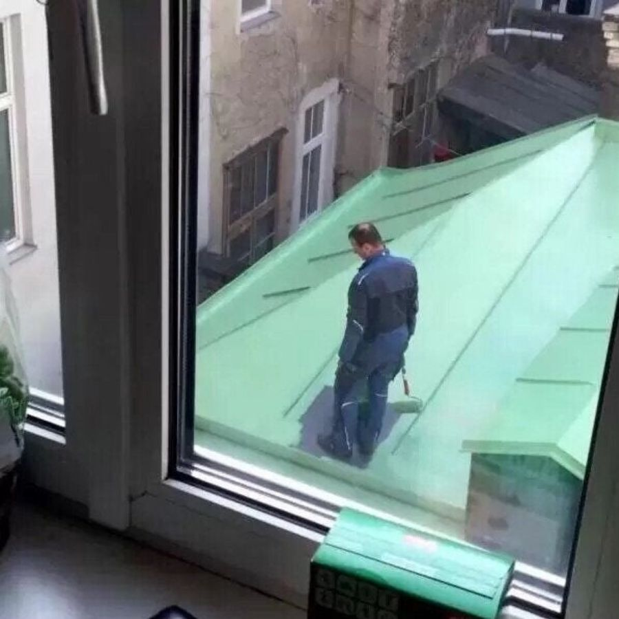 painter stranded on roof after painting all around him