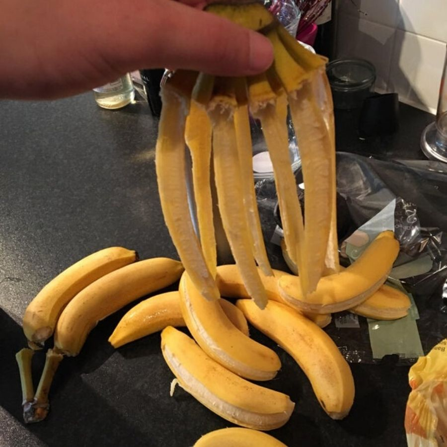 seven bananas that are too ripe and fell off their peels