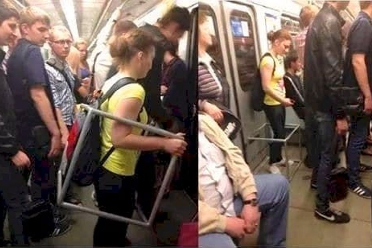 woman with four bars around her on the subway