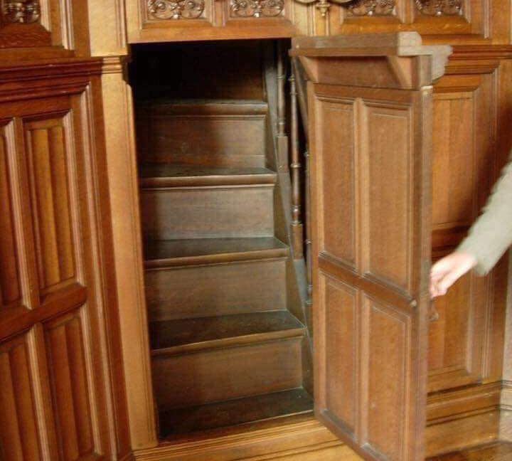 In a nineteenth-century Victorian home, a secret stairway provides access to servants.