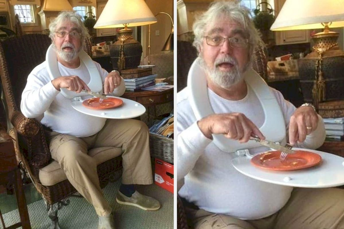 man eating dinner on chair with toilet seat around neck