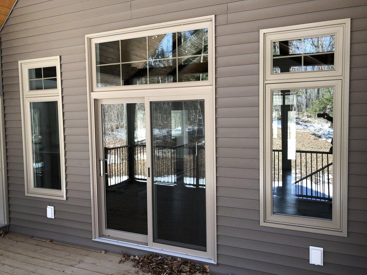 A porch door has transom windows above it.