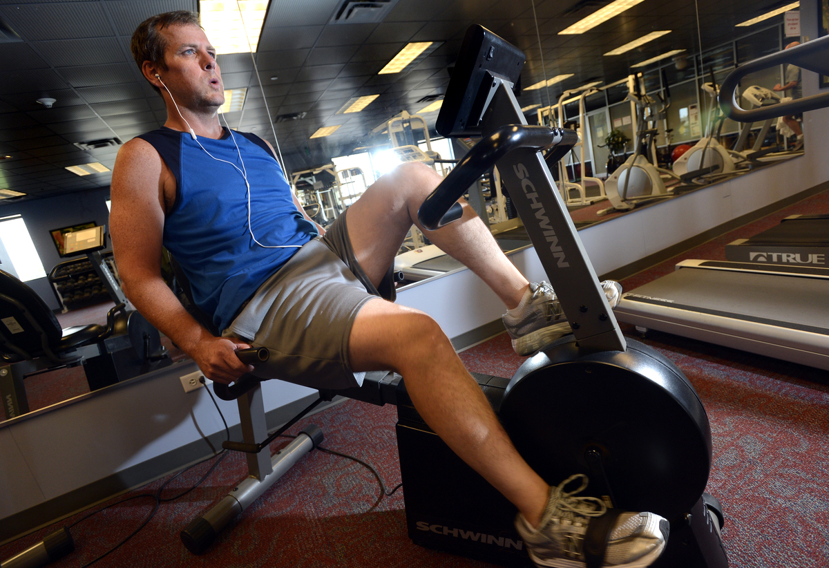 Clint Findley exercises on the stationary bike at the gym.