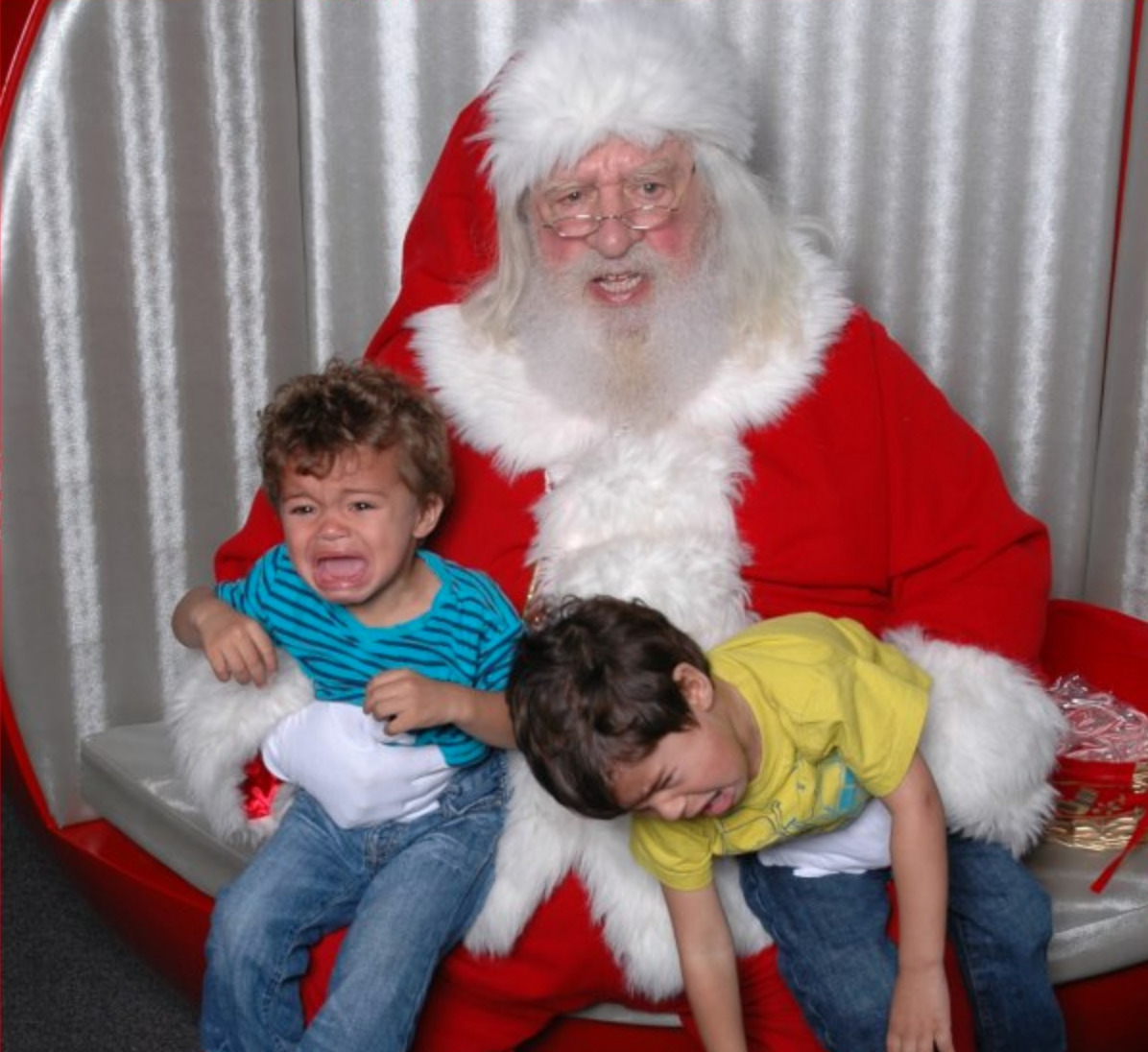 two boys sobbing during photo with santa