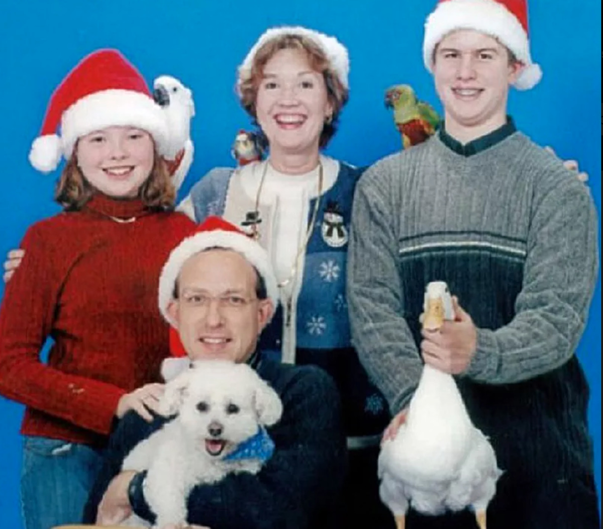 family has many birds ,including a duck, in Christmas photo
