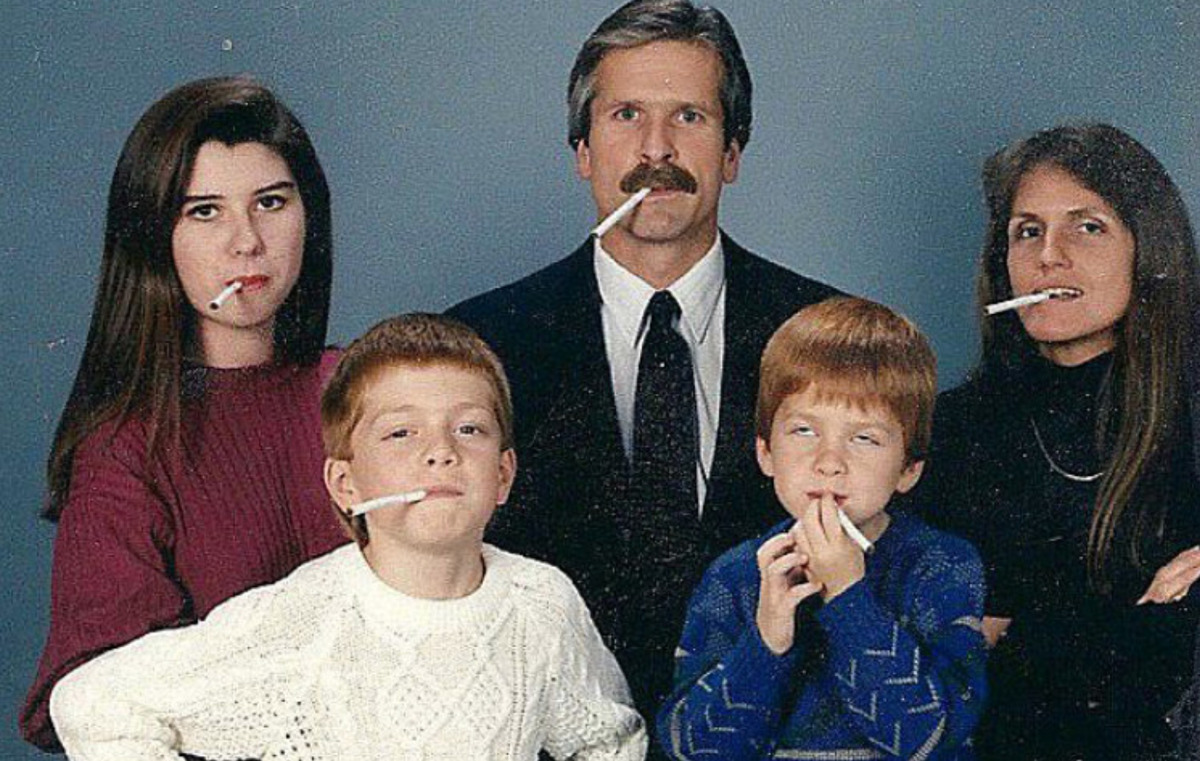 whole family has cigarettes in mouth