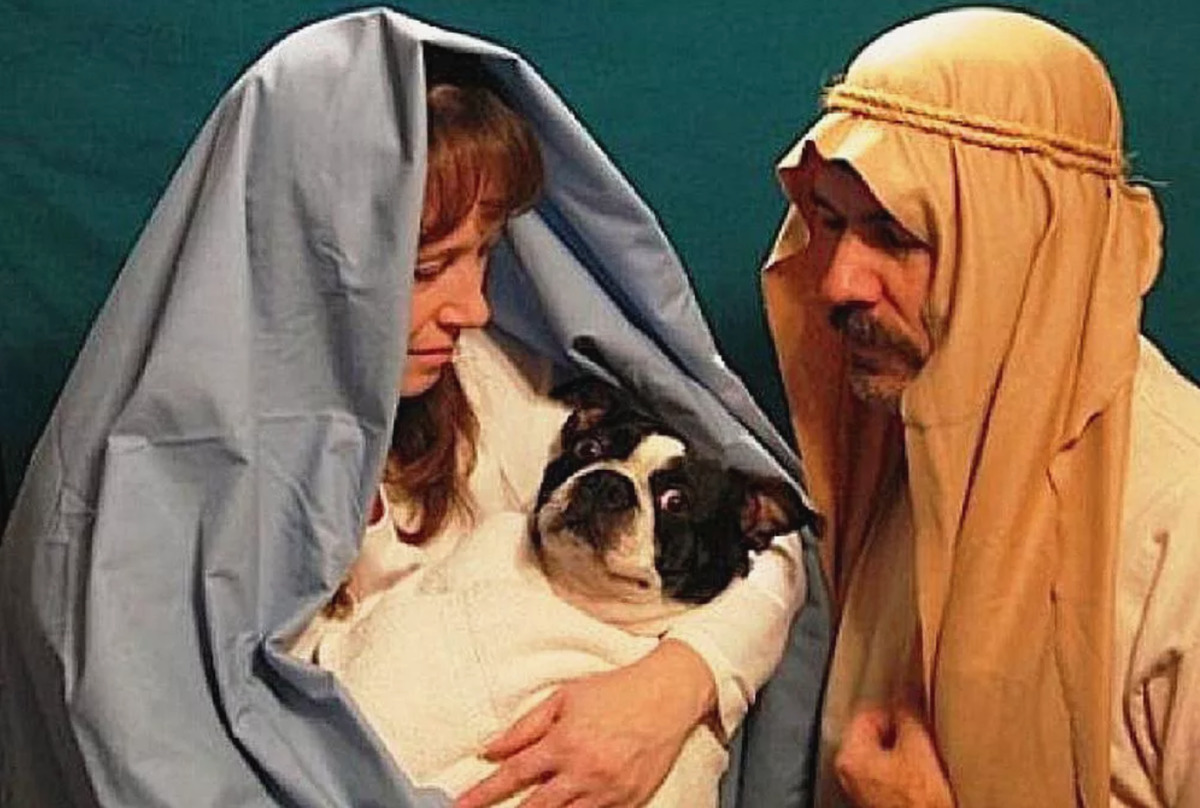 couple dressed as mary and joseph while dog is jesus