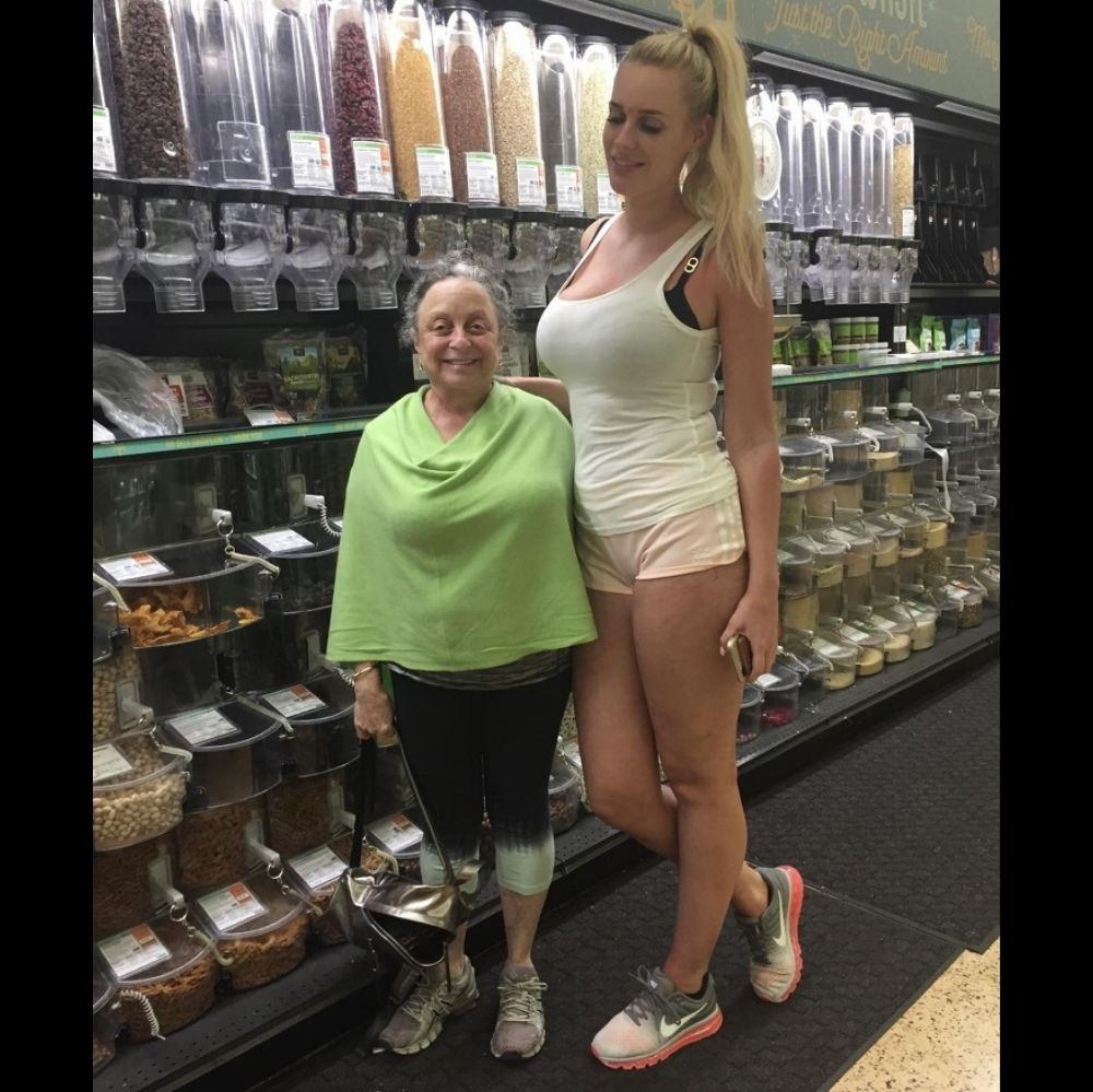Short older woman with very tall girl
