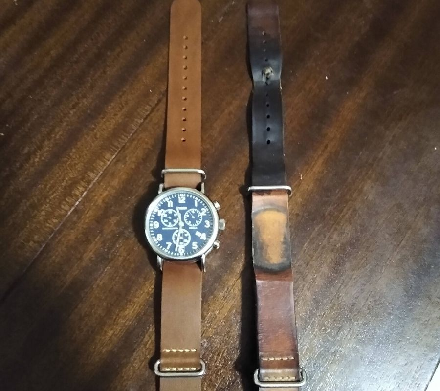 a watch next to its old worn out band