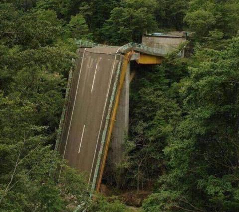 an abandoned roadway that's fallen apart