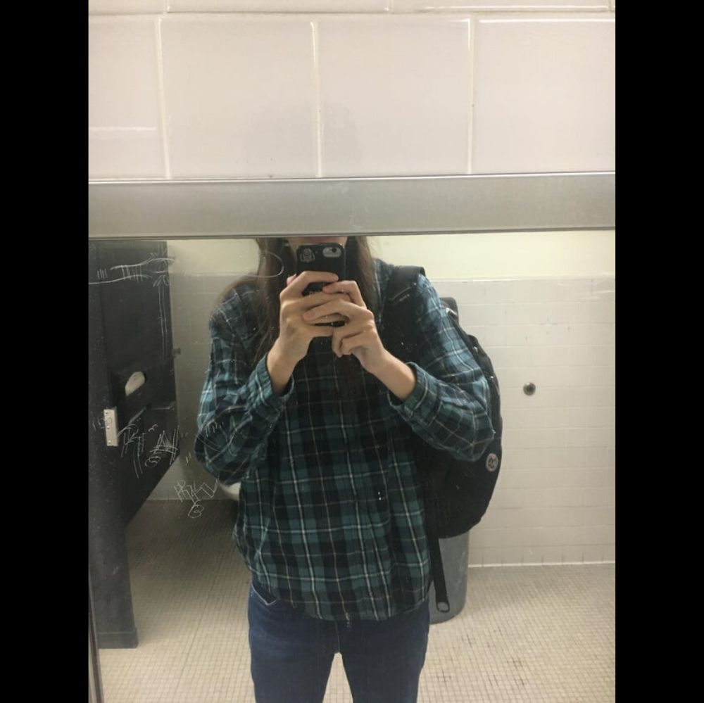 Person talking mirror selfie can't fit face in