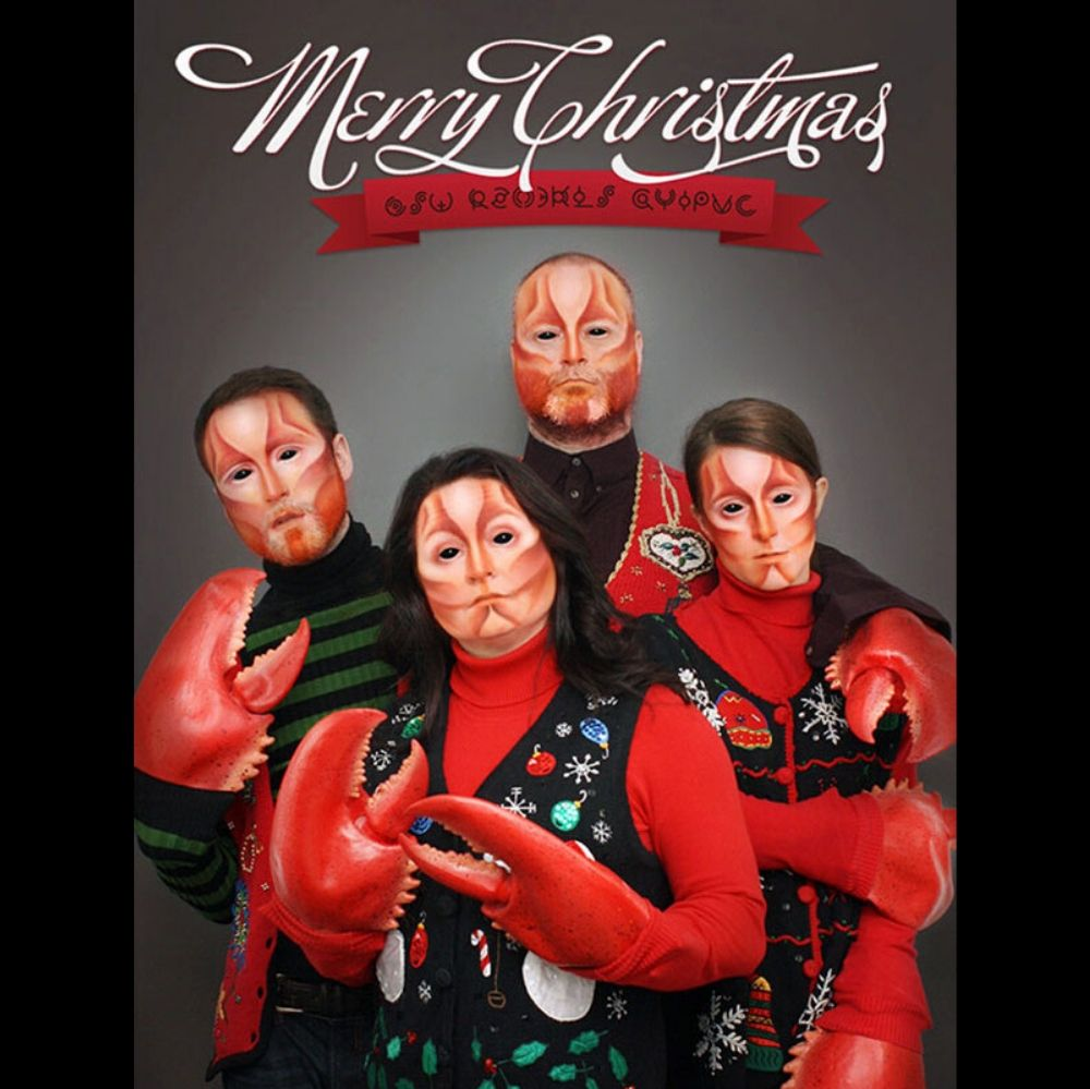 family dresses like lobsters for christmas card