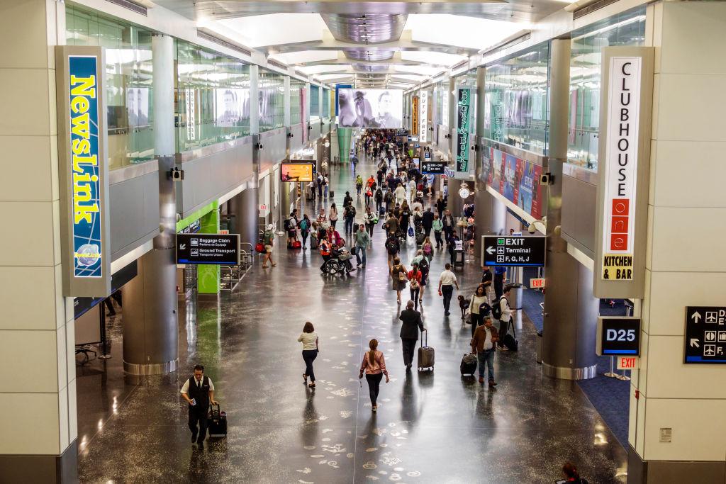 Florida, Miami International Airport, crowded concourse.