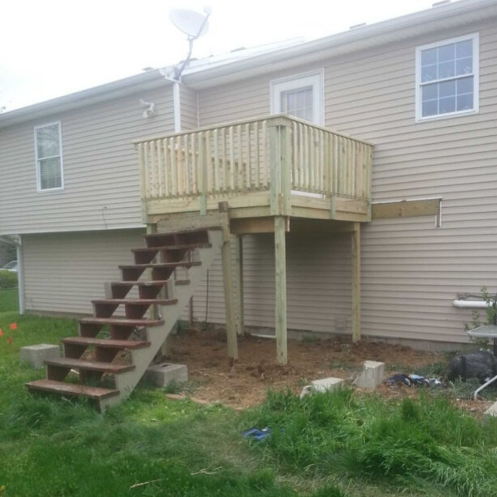 crooked porch and stairs to nowhere