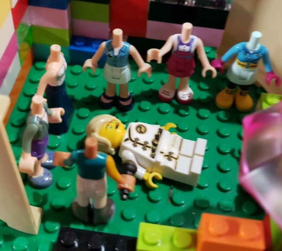 a kid set their legos up in a weird cult like way