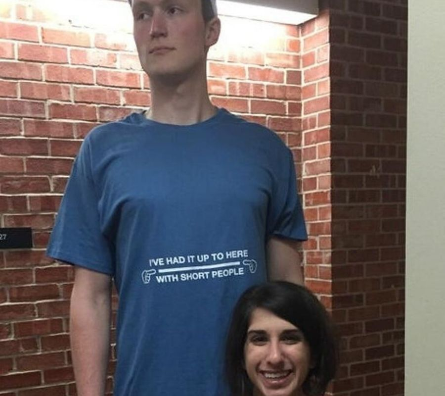 tall guy with a shirt that says ive had it up to here with short people