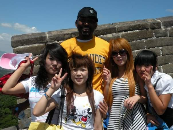 tall black man with tourists on Great Wall Of China